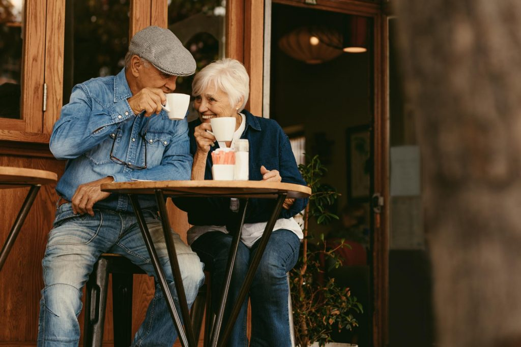 Elderly couple at a cafe as part of urban regeneration