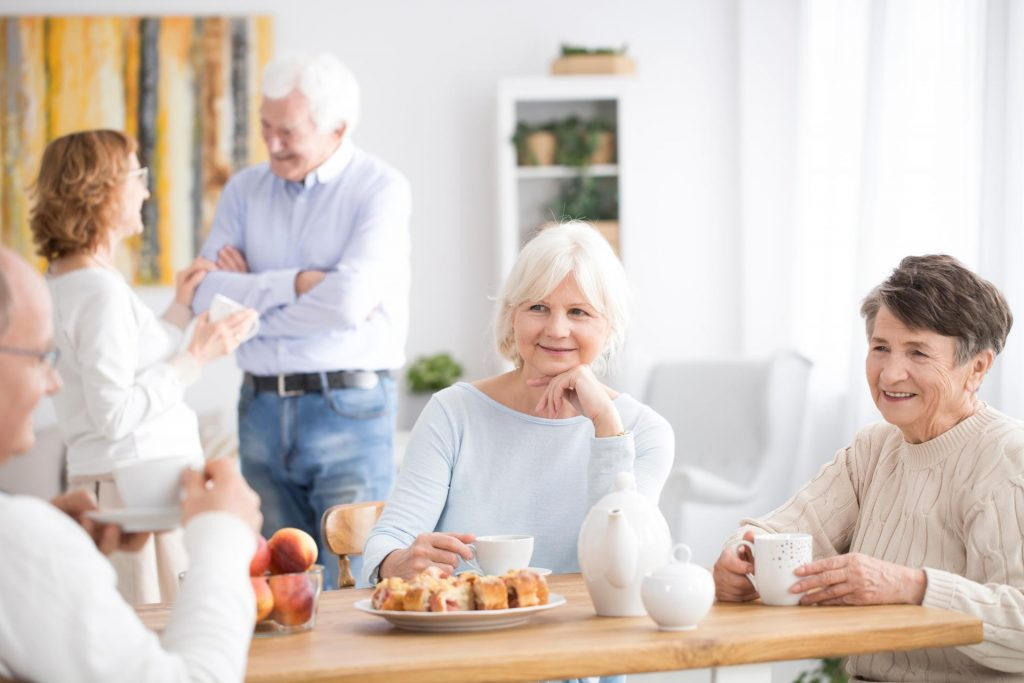 Elderly care home residents in dining room