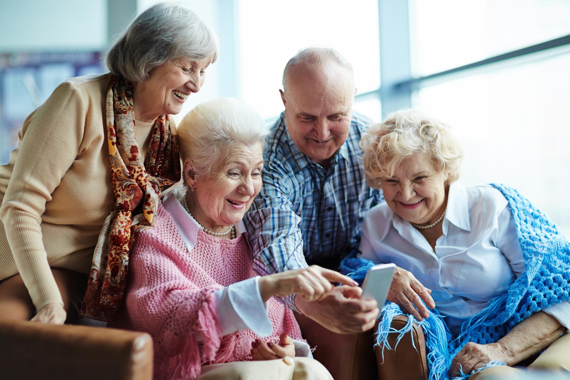 Group of elderly residents enjoying their care home